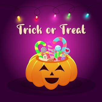 ガーランドとキャンディーとお菓子でいっぱいのハロウィーンのカボチャバスケット。レタリングをトリックオアトリートします。