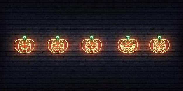 Halloween pumpkin neon sign. set of bright jack o lantern for halloween celebration