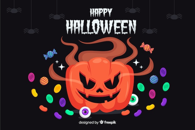 Halloween pumpkin surrounded by candies background