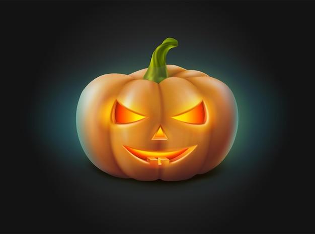 Zucca di halloween con la faccia luminosa al buio