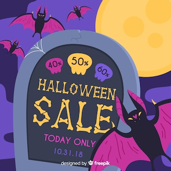 Halloween sale background with bat and tombstone