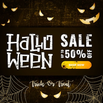 Halloween sale card  with glowing scary eyes and spider web on dark old scratched