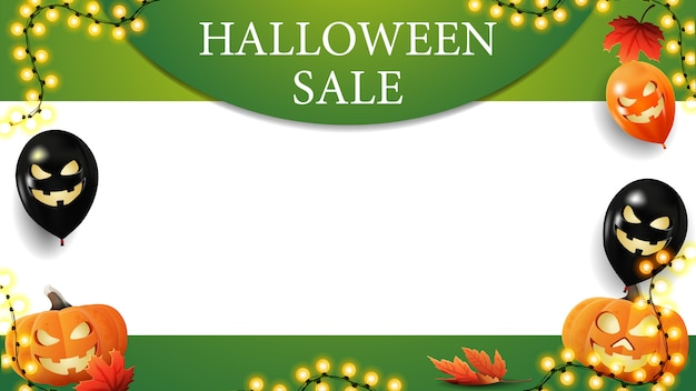 Halloween sale, green horizontal template for your arts with copy space. halloween balloons, garland and pumpkins