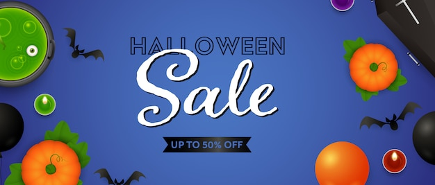 Halloween sale lettering, pumpkins, potion and candles