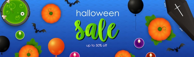 Halloween sale lettering with potion, pumpkins and coffin