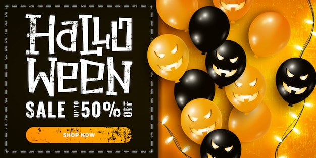 Halloween sale promotion banner with air balloons, garland lights on dark and orange