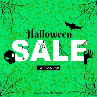 Halloween sales with cobwebs on green background