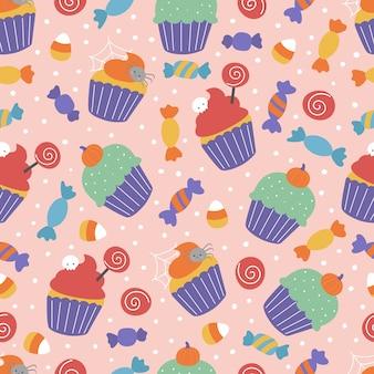 お菓子とハロウィーンのシームレスなパターン。不気味なカップケーキとピンクの背景のお菓子。