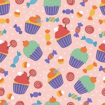 Halloween seamless pattern with sweets. spooky cupcakes and candies on pink background.