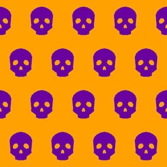 ハロウィーンの頭蓋骨のシームレスなパターンの背景。オレンジ色のカバーで分離された抽象的なハロウィーンの紫色の頭蓋骨。デザインカード、招待状、メニュー、アルバムなどの手作りの幾何学的なハロウィーンの頭蓋骨のパターン。