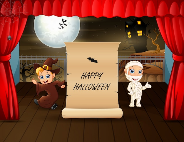 Halloween text with mummy and witch on stage