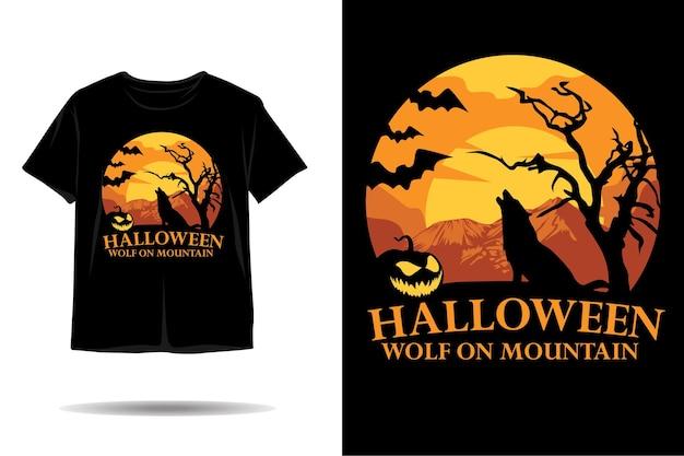 山のシルエットのtシャツのデザインのハロウィーンのオオカミ