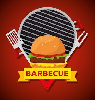 Hamburger in the grill with fork and bbq utensils