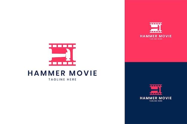 Hammer movie negative space logo design