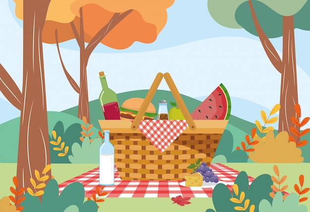 Hamper with hamburger and wine bottle with watermelon