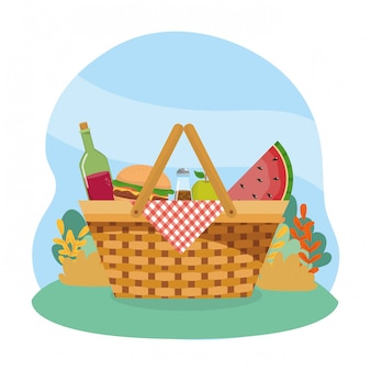Hamper with wine bottle and hamburger and watermelon