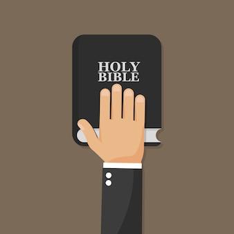 Hand on bible.