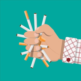 Hand breaks cigarettes.