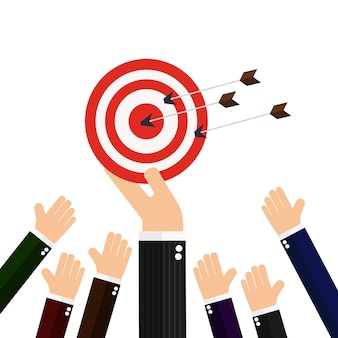 Hand of businessman hold target with arrow
