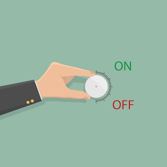 Hand of businessman hold on volume control.