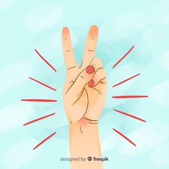Рука делает знак мира с ручным рисунком