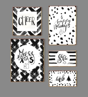 Hand drawn abstract dirty brush stroke textured christmas and new year greeting card template collection set with xmas modern ink lettering phases and quotes in gold,black and white colors.