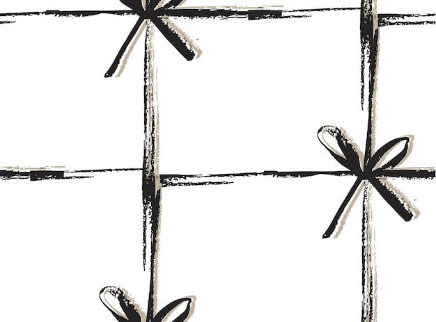 手は白い背景の上の弓で抽象的なメリークリスマス装飾パターンを描画します。シンプルな珍しいユニークなパターン。ギフトを与える概念。ファッションと包装紙。