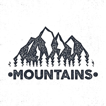 Hand drawn adventure label. mountains and forest illustration.