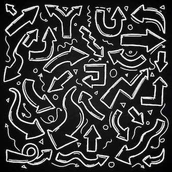 黒板に手描きの矢印チョーク