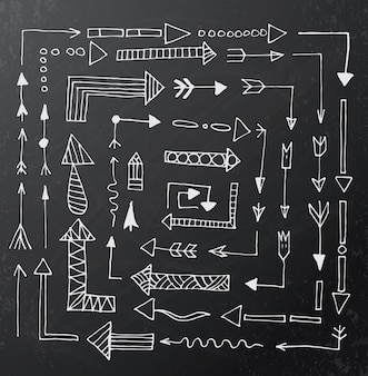 Hand drawn arrow icons set on black chalk board