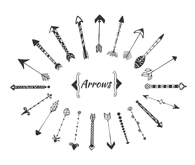 招待状の装飾のためのインクベクトル要素で手描きの矢印のコレクション。