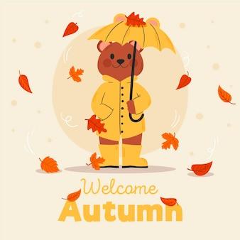 手描きのクマと秋の背景