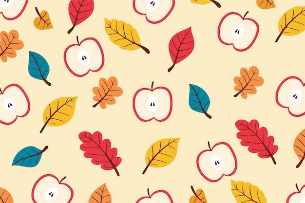 葉とリンゴと手描きの秋の背景
