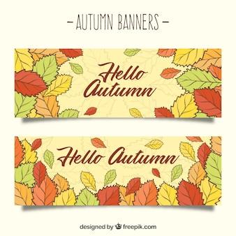 Bandiere autunnali disegnate a mano con foglie colorate