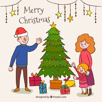 クリスマスツリーの横に家族と手描きの背景