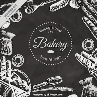 Hand drawn bakery products background in chalkboard effect