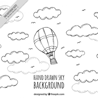 Hand drawn balloon flying between clouds background