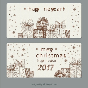 Hand-drawn banners with decorative gifts for new year
