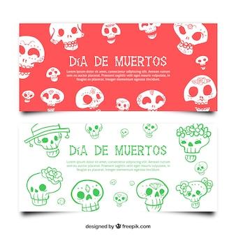 死者の日にメキシコの頭蓋骨と手描きのバナー