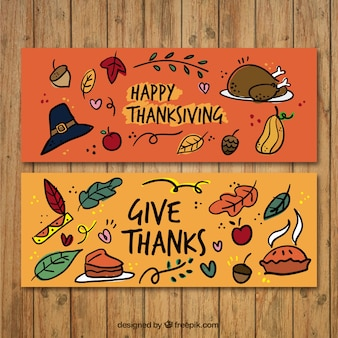 Hand-drawn banners with traditional items for thanksgiving