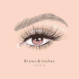 긴 검은 속눈썹과 눈썹으로 손으로 그린 아름다운 여성의 눈