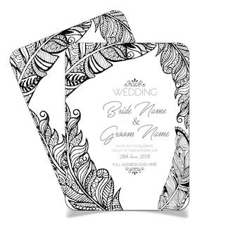 手描きの黒と白の羽のウェディングカード