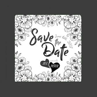 手描きの白と黒の花の結婚式招待状
