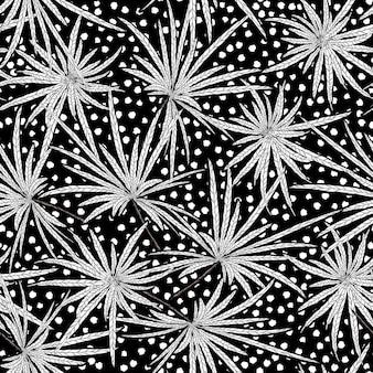 ドットのシームレスなパターンで手描きの黒と白の葉