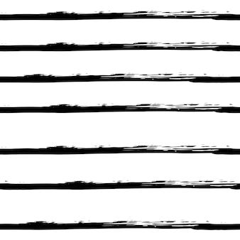 グランジスタイルの手描きの黒と白のシームレスなパターン。ブラシストロークの形状