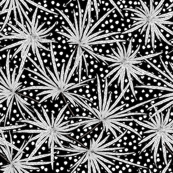 Hand drawn black and white leaves with dots seamless pattern