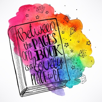 Hand-drawn book with the quote on the cover on a watercolor background