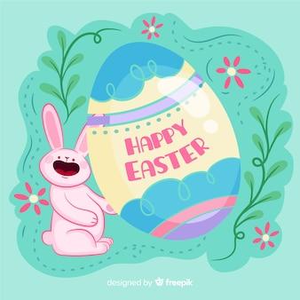 Рисованной кролик держит большое пасхальное яйцо