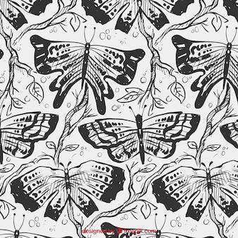 손으로 그린 나비와 가지 패턴