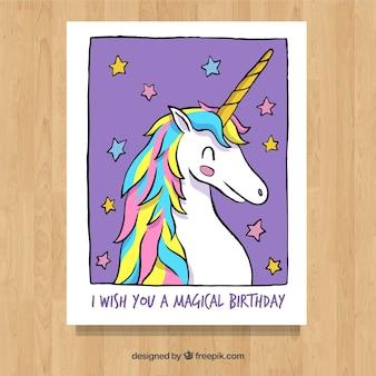 Scheda disegnata a mano con smiley unicorno e stelle